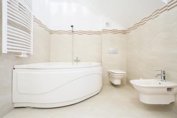 Large bath in luxurious bathroom
