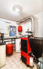 interior household boiler with a boiler for solid fuels