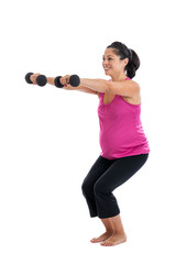 Fit pregnant woman lifting weights