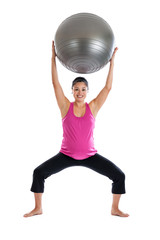 Fit pregnant woman lifting exercise ball