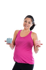 Pregnant woman with piggy banks