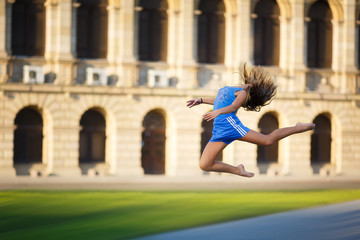 Young gymnast flying in jump
