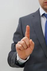 man holding finger up