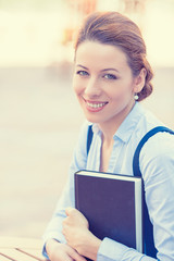 professional, beautiful confident businesswoman with book