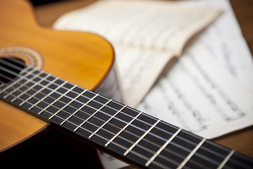 The concept of musical notes and guitar in the background