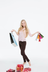 Young beautiful woman in a full with shopping bags