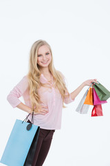 Young beautiful woman with shopping bags and gifts
