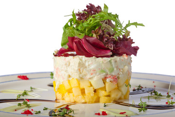 crab salad with vegetables on a plate