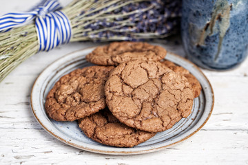 Plate of chocolate cookies on rustic table