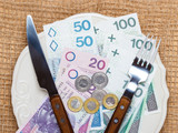 Polish money on kitchen table, coast of living - 78671332