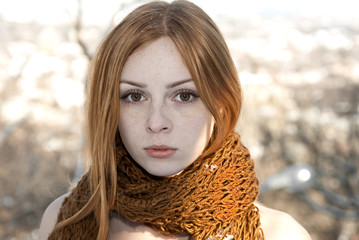 closeup portrait of beautiful pure girl in scarf winter