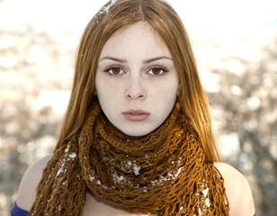 closeup portrait of beautiful girl in snow-covered scarf