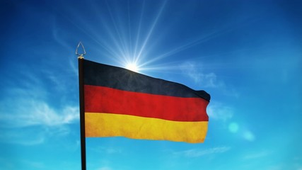 flag of Germany waving over sunny blue sky with some clouds