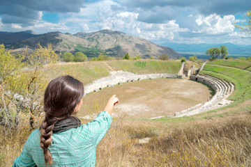 Young tourist at Alba Fucens, the amphitheater, Abruzzo Italy