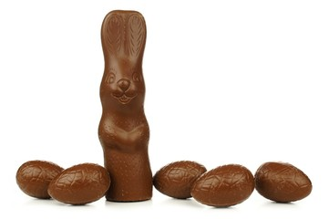 Chocolate bunny with Easter eggs on white