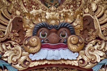 Wooden sculpture the demon in temple in Ubud, Bali, Indonesia