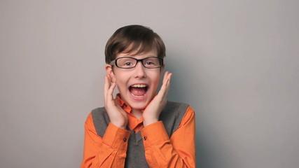 boy teenager surprise happiness joy waves  his hands for ten