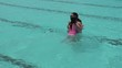 Girl child jumps into swiming pool