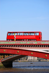 Red double decker bus on Blackfriars bridge in London