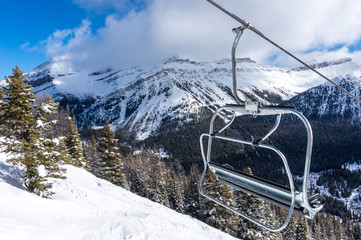 Ski Lift Chair With View of Snowy Mountains