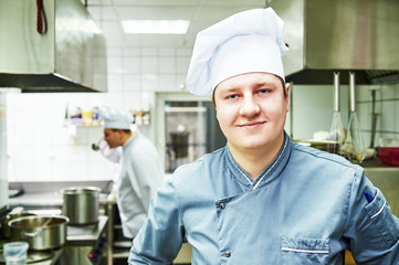 cook chef at restaurant kitchen