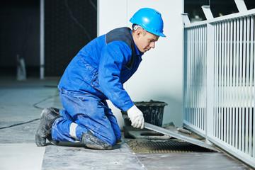 tiler at industrial floor tiling renovation