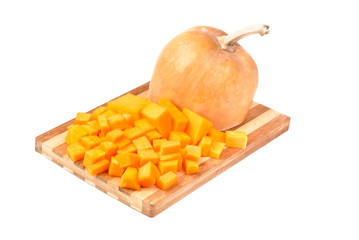 Slices of pumpkin on cutting board isolation on white