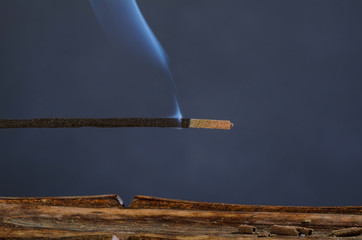 Closeup take of a burning incense stick