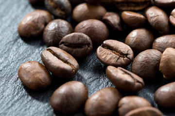 coffee beans on a dark background, selective focus, close-up