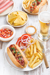 fast food - hot dog with French fries, beer and snacks, vertical