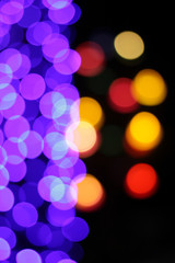 Colorful defocused bokeh lights background.