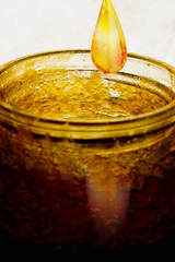Rim of the jar with crystallized honey and honey drop