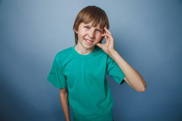 boy teenager European appearance brown hair in a turquoise t-shi