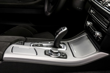 Automatic transmission gear shift. Modern car interior detail.