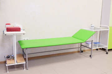 Patient examination table in a doctors office