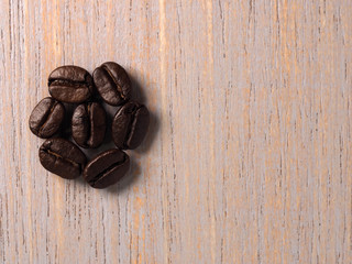 Coffee crop on wood texture background