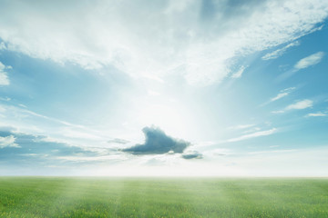 Clouds with sunbeams on blue sky in summer