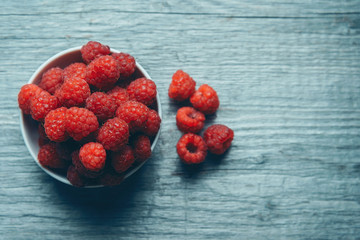 Fresh ripe raspberries in a bowl