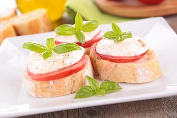 tomato, mozzarella and basil on bread