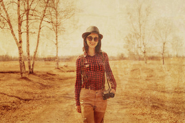 Beautiful young woman with photo camera, vintage image