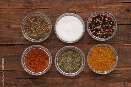 cups with different spices - 78680978