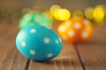 Easter eggs on wooden boards