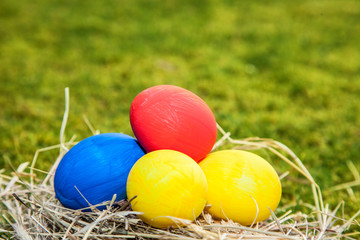 Easter eggs lying in straw