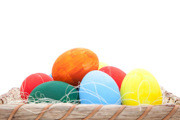 Easter eggs in basket. All on white background.