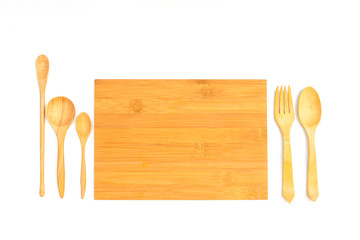 Wooden cutting board with wooden spoon and fork isolated