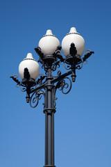 Street cast iron antique lamp with three white plafonds