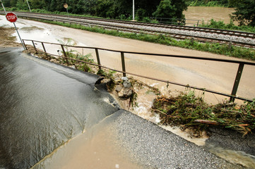 Flood aftermath with damaged road