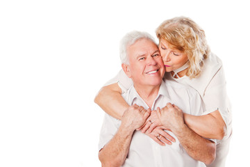 Portrait of happy seniors couple in love. Isolated over white