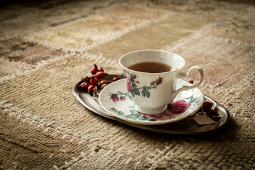 Tea cup on tray, vintage style