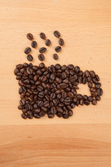 Roasted coffee beans in coffee cup shape